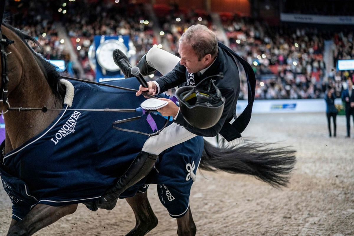 "Geir Gulliksen of Norway falls off his horse ""Groep Quatro"" after winning the FEI Jumping World Cup competition during Gothenburg Horse Show at Scandinavium Arena in Gothenburg on February 23, 2020. PHOTO: AFP"