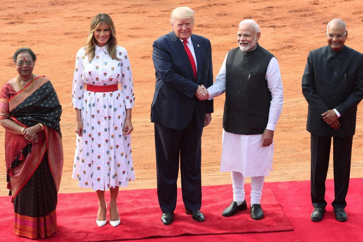 (From left) Savita Kovind, first lady Melania Trump, US President Donald Trump, India's Prime Minister Narendra Modi and India's President Ram Nath Kovind pose for a photo during Trump's ceremonial reception at the forecourt of India's Rashtrapati Bh