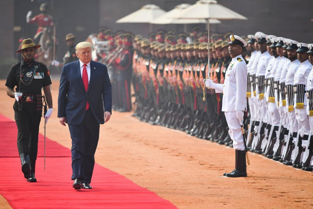 US President Donald Trump reviews a guard of honour during a ceremonial reception at Rashtrapati Bhavan - The Presidential Palace in New Delhi, India, on Feb 25, 2020.