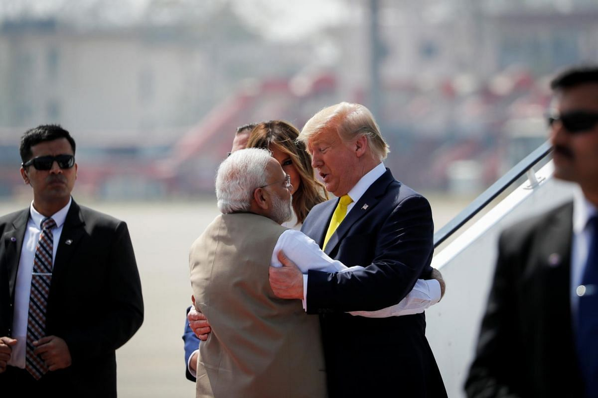 US President Donald Trump (right) greets Indian Prime Minister Narendra Modi as he arrives at Sardar Vallabhbhai Patel International airport in Ahmedabad, India, on Feb 24, 2020.