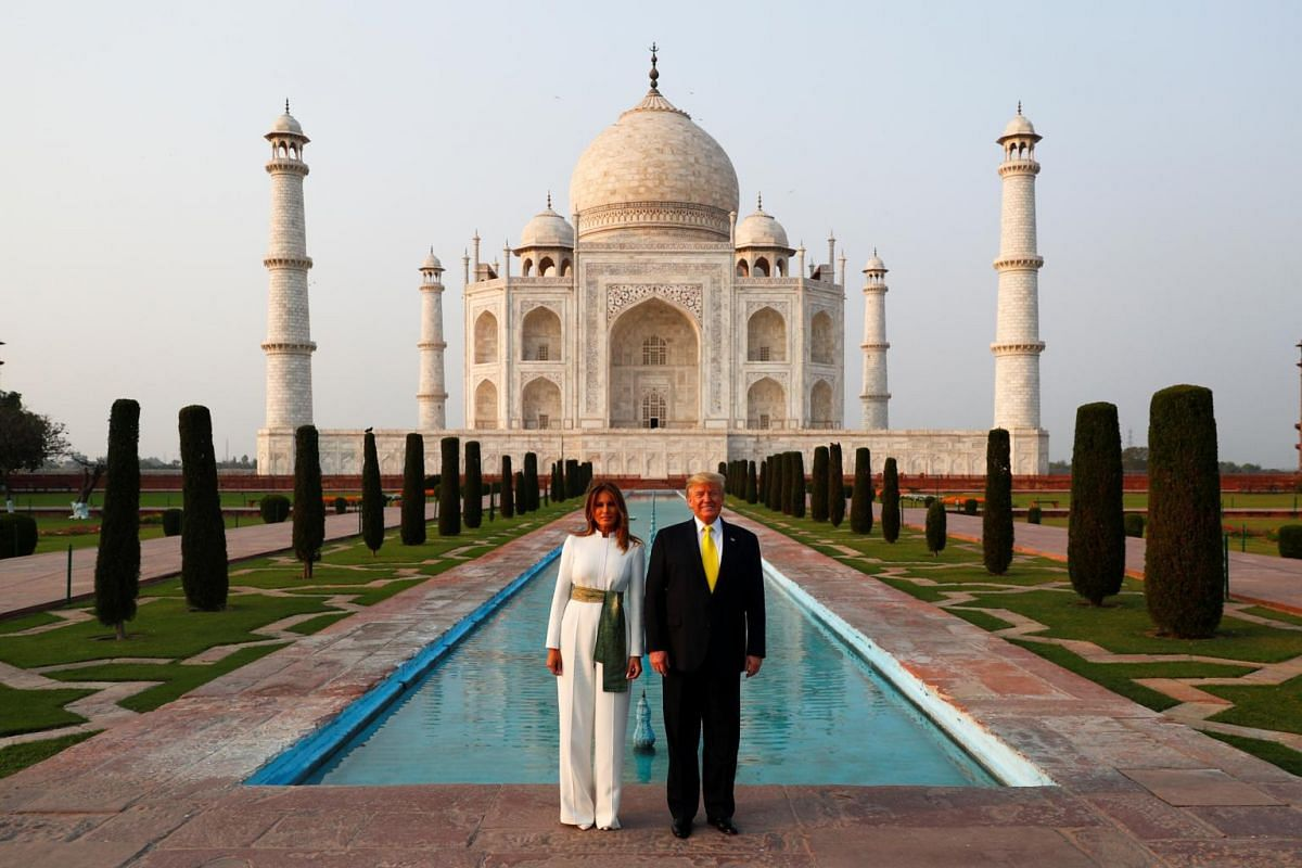 US President Donald Trump and first lady Melania Trump pose as they tour the historic Taj Mahal, in Agra, India, on Feb 24, 2020.