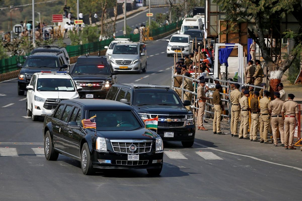 "The armored limousine known as ""The Beast"" carrying US President Donald Trump and first lady Melania Trump passes enroute to Sardar Vallabhbhai Patel International Airport in Ahmedabad, India, on Feb 24, 2020."