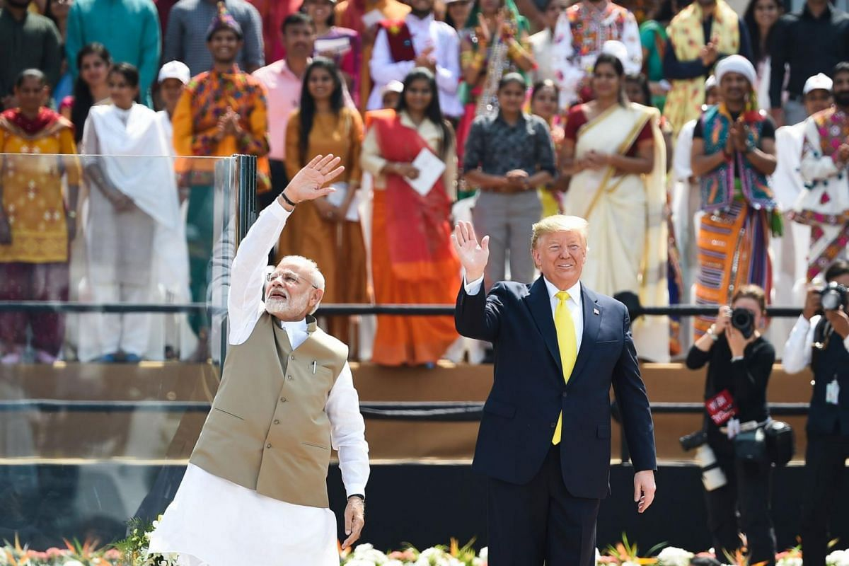 US President Donald Trump (right) and India's Prime Minister Narendra Modi wave at the crowd during 'Namaste Trump' rally at Sardar Patel Stadium in Motera, on the outskirts of Ahmedabad, India, on Feb 24, 2020.