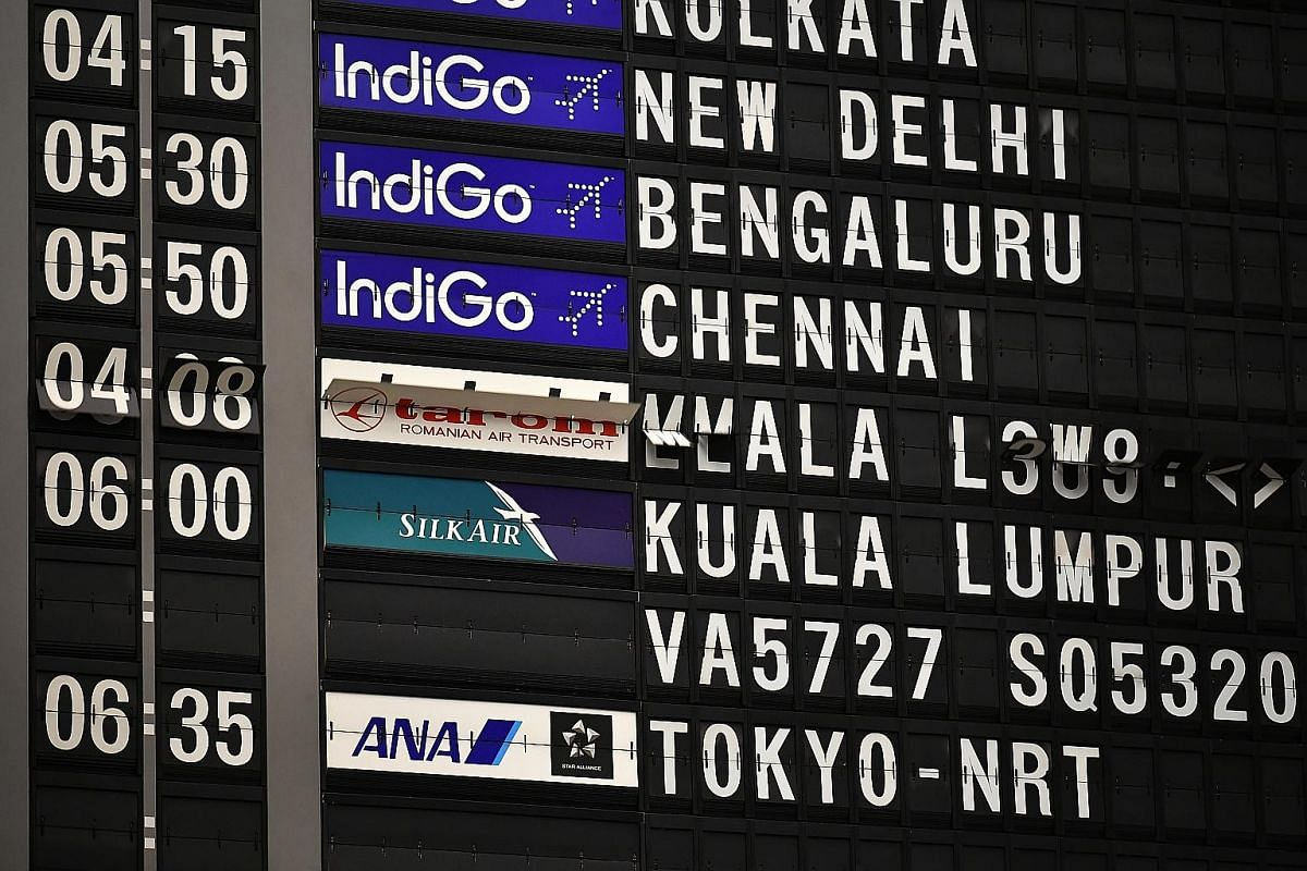 Above: The analogue flip board flipping to reflect flight information before it was decommissioned at about 11.30pm on Feb 6. The board has about 1,600 single-character capsules, about 240 double-character capsules to indicate time, and 240 capsules