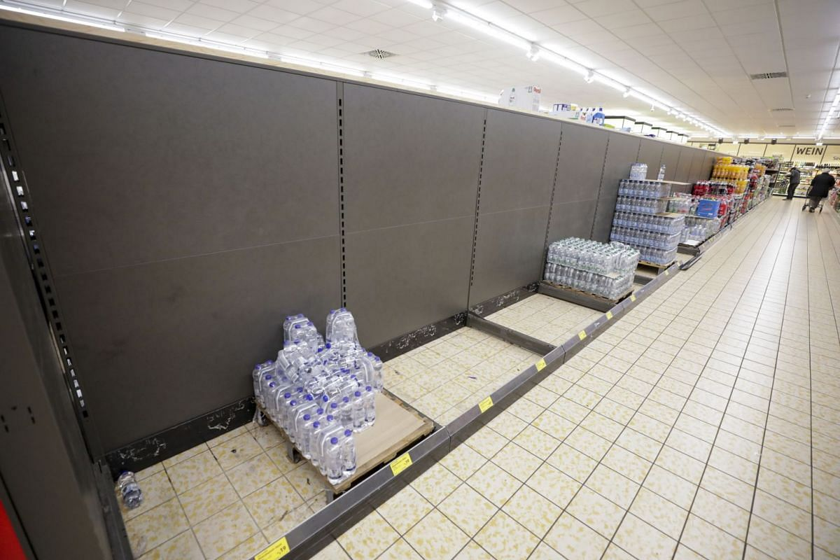 The last remaining bottles of drinking water sit in an almost empty aisle inside an Aldi Stores Ltd. supermarket in Hanau, Germany, on March 2, 2020.