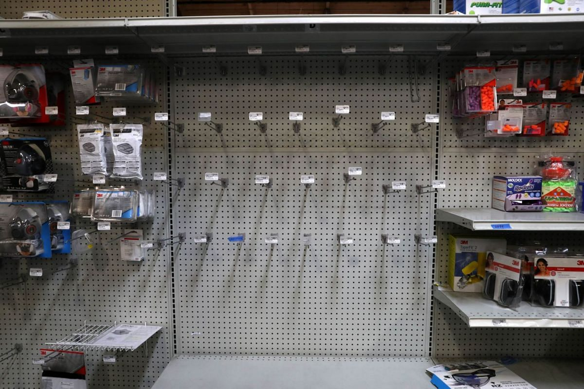 Shelves where protective masks were once displayed sit empty at Jackson Hardware in San Rafael, California, on March 2, 2020.