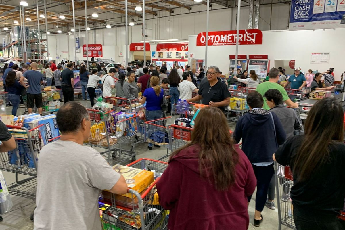 People buy water, food and toilet paper at a store, as they begin to stockpile essentials from fear that supplies will be affected by the spread of the coronavirus outbreak across the country, in Los Angeles, California on Feb 29, 2020.