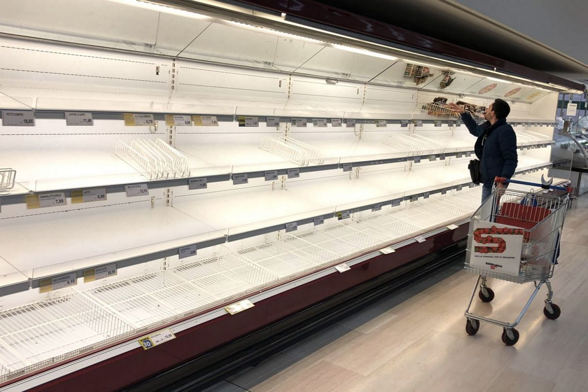 Empty shelves are seen at a supermarket as people stockpile due to the fear of the coronavirus, in Pioltello near Milan, Italy, on Feb 24, 2020.