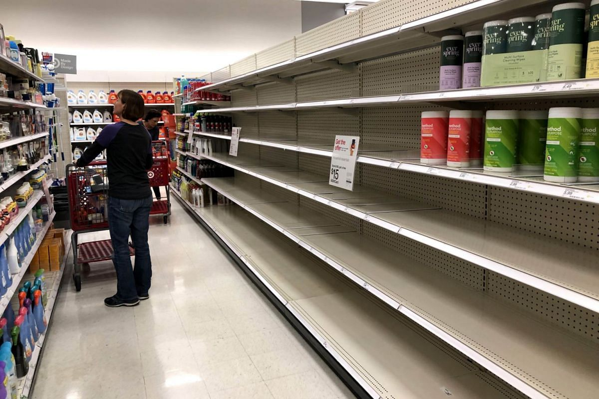 Shelves where disinfectant wipes are usually displayed is nearly empty at a Target store in Novato, California on March 2, 2020.