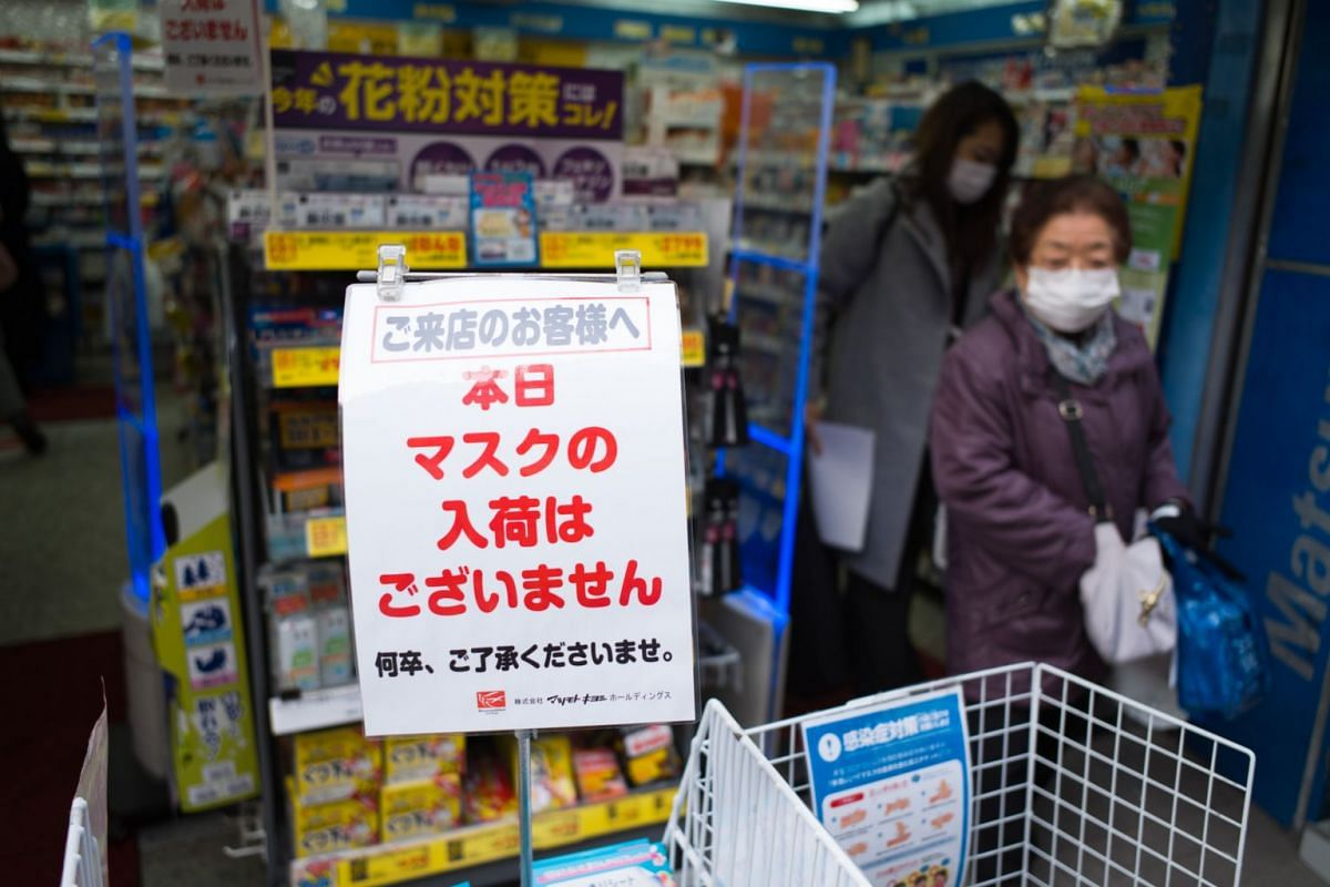 A notice indicates that protective masks are sold out outside a drug store in Tokyo, Japan, on Feb 28, 2020.