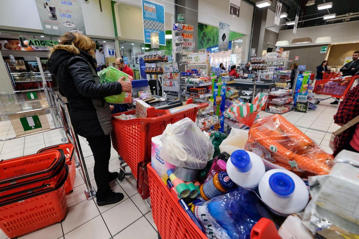 Empty shelves are seen at a supermarket as people stockpile due to the fear of the coronavirus in Palermo, Italy, on Feb 24, 2020.