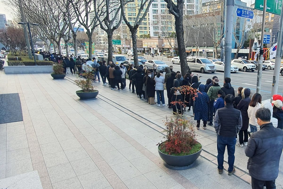 Citizens form a long queue to purchase masks at a post office, in Daegu, South Korea, on Feb 27, 2020.