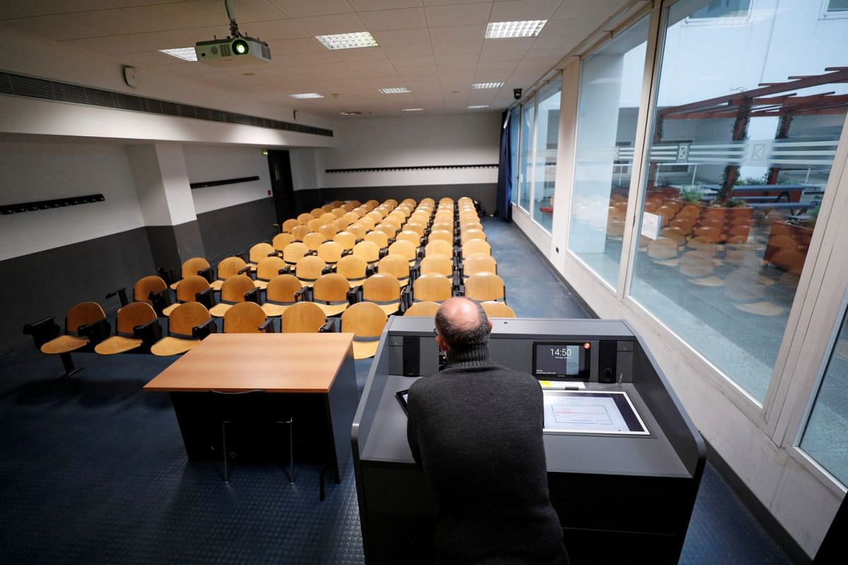 University chemistry professor Luca De Gioia recording his lesson in an empty classroom to stream it online for his students at the Bicocca University in Milan on March 2, 2020.