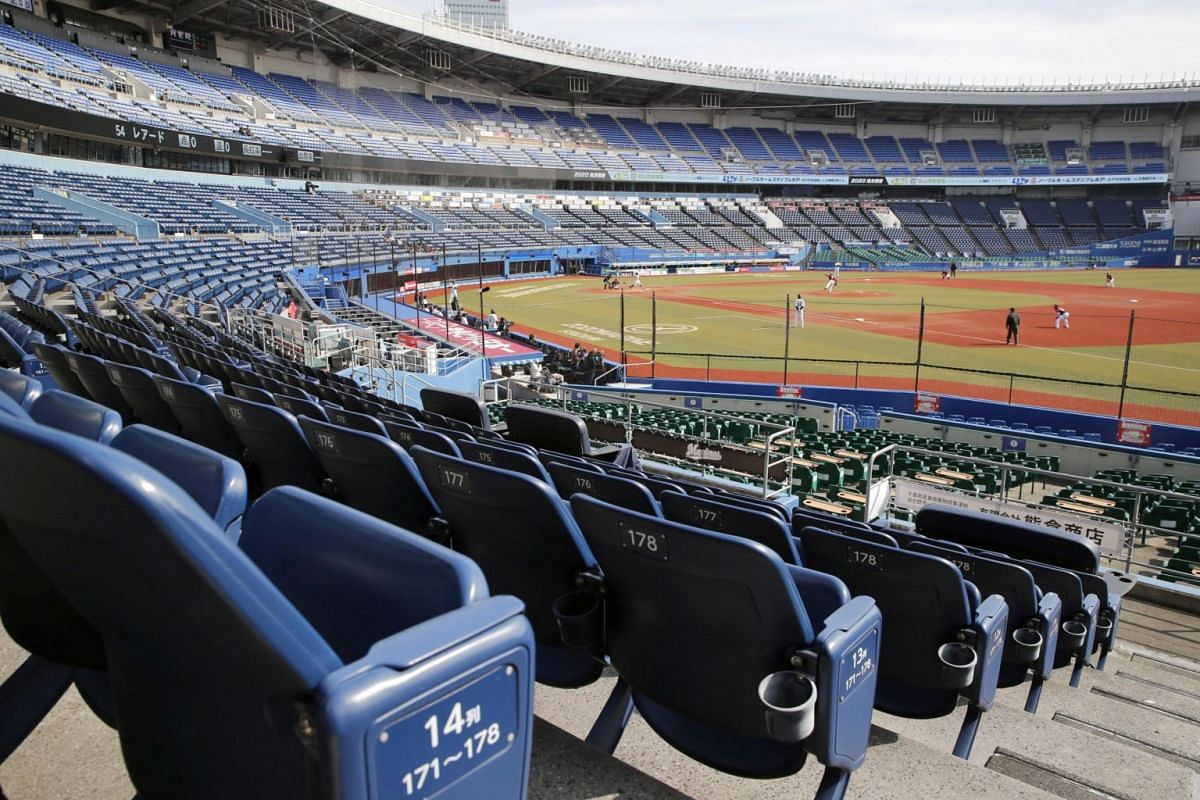 Empty spectator stands during a baseball game between Chiba Lotte Marines and Tohoku Rakuten Golden Eagles, which is taking place behind closed doors  at a stadium in Chiba, Japan, on Feb 29, 2020.