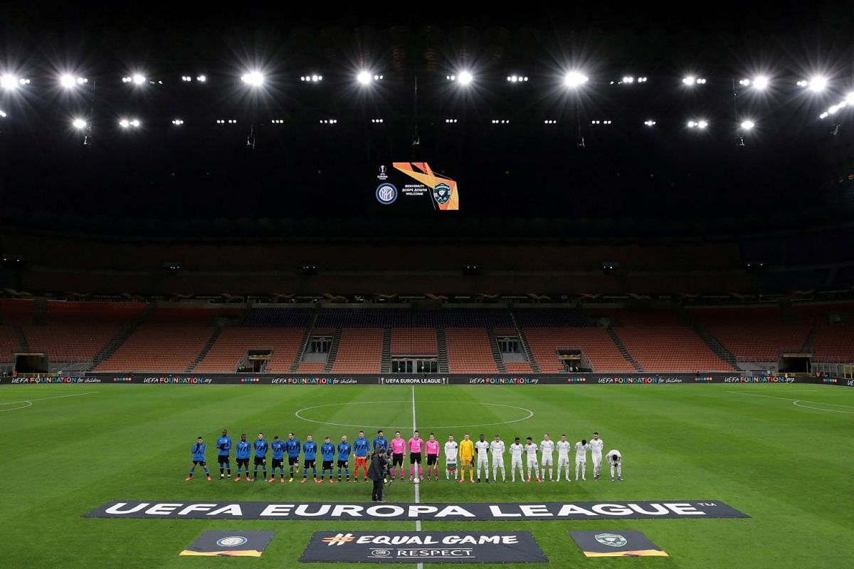 Inter Milan and Ludogorets football teams lining up before a Europa League match in an empty stadium in Milan on Feb 27, 2020, after fans were not allowed in over coronavirus fears.