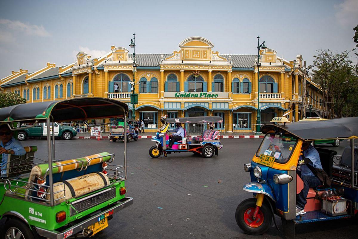 Drivers in tuk-tuks searching for customers in Bangkok on Feb 26, 2020.