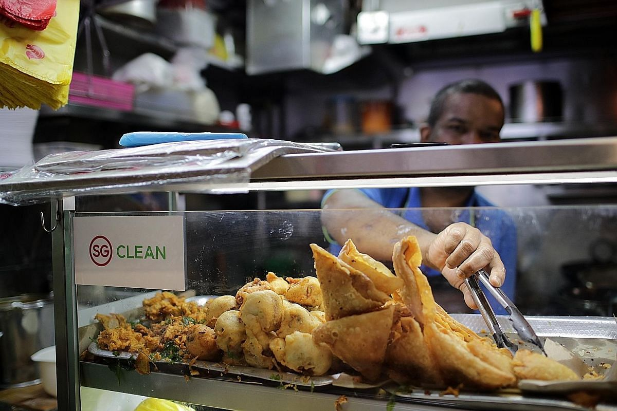 Diners queueing up to wash hands at Tiong Bahru Market before eating or after returning used crockery. ST PHOTO: CHONG JUN LIANG People are still leaving their used crockery, leftovers and used tissue paper behind for workers to clean up after them,