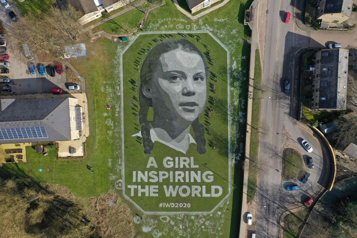 "This handout image made available on March 8, 2020 by British art group ""Sand In Your Eye"" shows an aerial view taken on March 6, 2020 above Hebden Bridge, near Leeds, north of England, of a 60m portrait of Swedish climate activist Greta Thunberg ent"