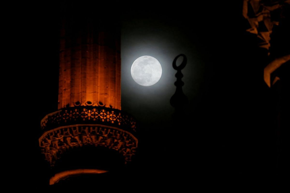 The full moon rises over the Selimiye Mosque in Edirne, Turkey, March 8, 2020. PHOTO: REUTERS