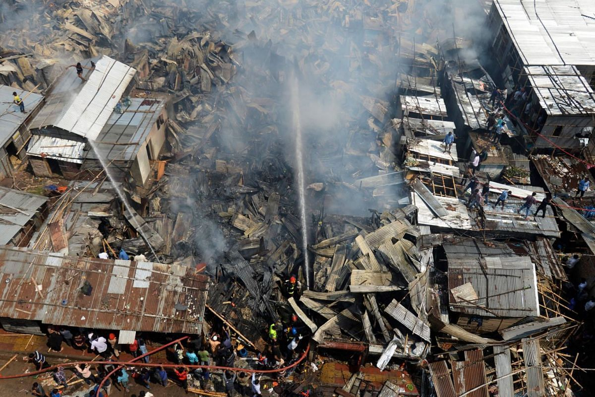 Firefighters work to extinguish a fire at a slum area in Dhaka on March 11, 2020. PHOTO: AFP
