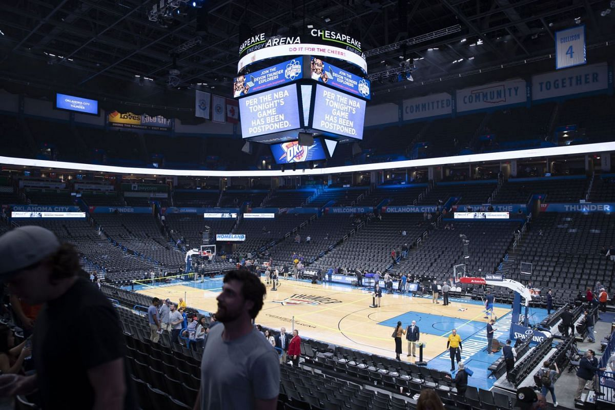 Fans leaving the Chesapeake Energy Arena in Oklahoma City after the abrupt postponement of the Jazz's NBA game against hosts Thunder on March 11, 2020, following news that a  Jazz player tested positive for coronavirus. PHOTO: PHOTO: USA TODAY SPOR