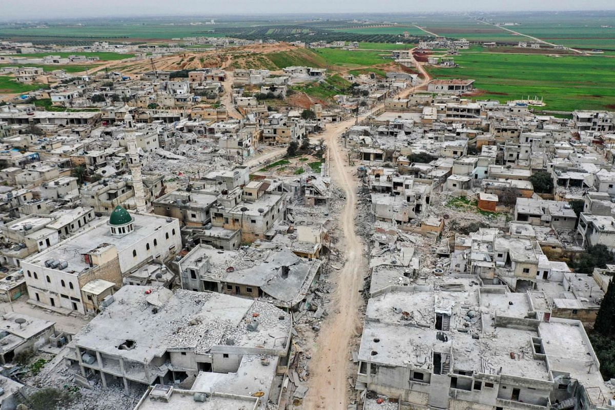 This picture taken on March 12, 2020 shows an aerial view of the town of Afis, which has sustained widespread destruction due to heavy fighting and air-strikes by pro-Syrian regime forces, in the northwestern Idlib province. PHOTO: AFP