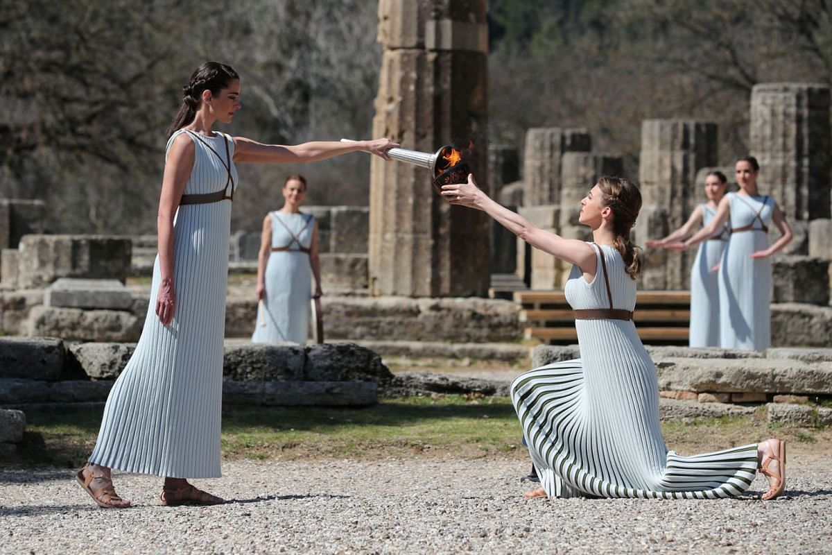 Greek actress Xanthi Georgiou, playing the role of High Priestess, lights the flame during the Olympic flame lighting ceremony for the Tokyo 2020 Summer Olympics at Ancient Olympia, in Olympia, Greece on March 12, 2020. PHOTO: REUTERS