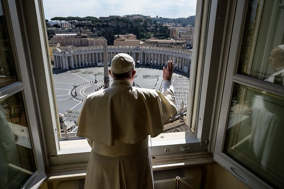 Pope Francis blessing over an empty St. Peter's Square at the Vatican, after his streamed Angelus prayer, on Mar 15, 2020. The Vatican said that its traditional Easter week celebrations would be held this year without worshippers due to the coronavir