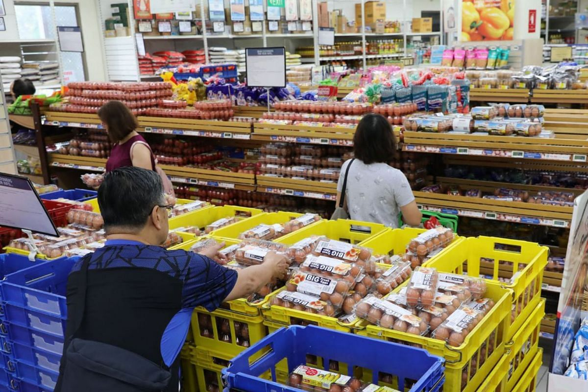 People buy eggs and other groceries at the Hougang 1 outlet of FairPrice Xtra on March 17, 2020. Singapore has made contingency plans for a disruption of food supply from Malaysia and has more than three months' worth of stockpile if Singaporeans buy