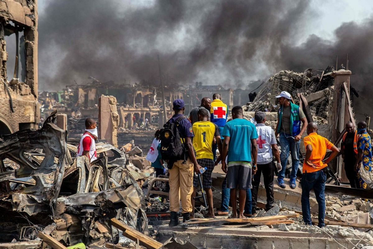 Rescue and other workers at the scene of a gas explosion in Nigeria's commercial capital Lagos which destroyed buildings and killed at least 15 people on March 15, 2020. PHOTO: AFP