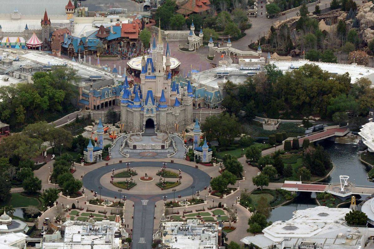 Cinderella Castle is seen at the end of an empty Main Street at Disney's Magic Kingdom theme park after it closed in an effort to combat the spread of coronavirus disease (COVID-19), in an aerial view in Orlando, Florida, U.S. March 16, 2020. PHOTO: