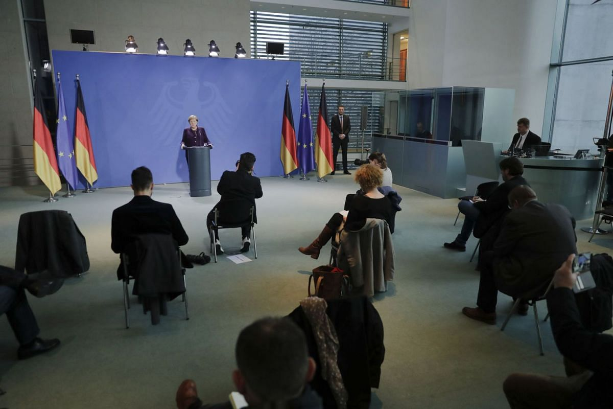German Chancellor Angela Merkel makes a press statement, where the limited number of journalists allowed in were placed at a distance to each other, to counter any spread of the coronavirus COVID-19 at the Chancellery, in Berlin on March 16, 2020. PH