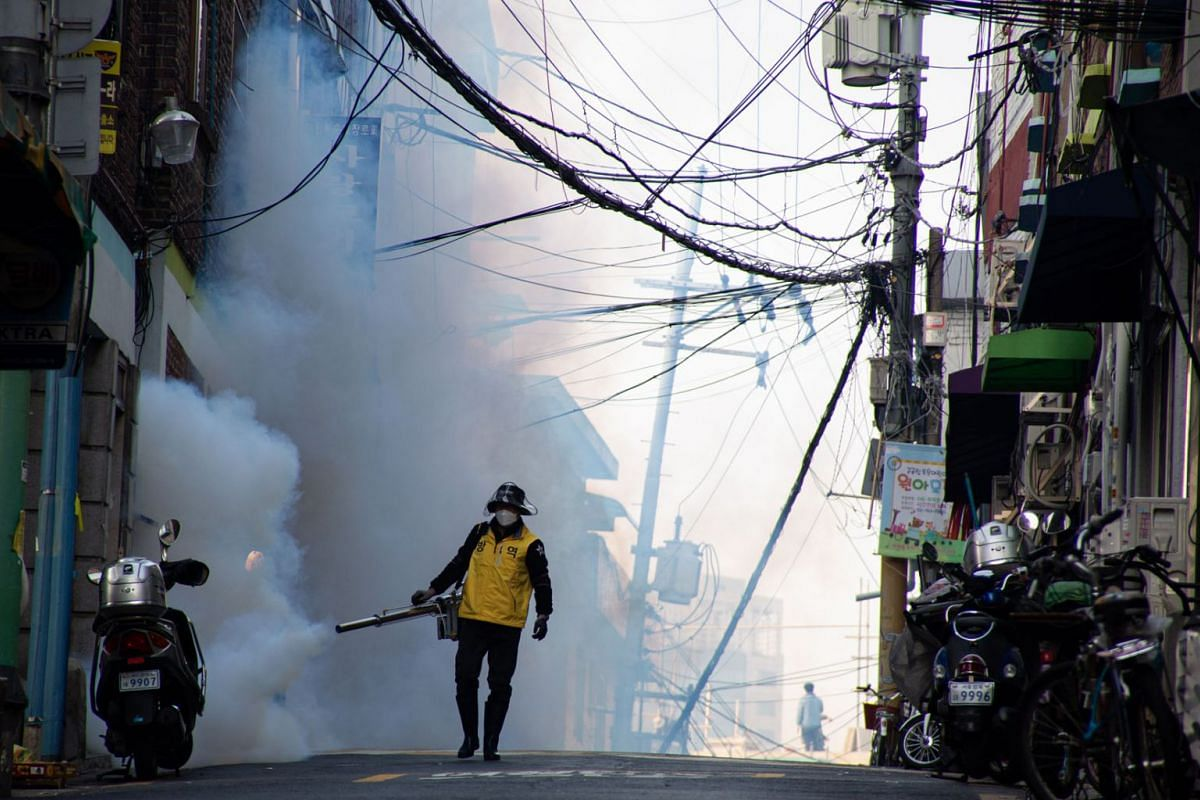 A South Korean worker spraying disinfectant as a precaution against further spread of coronavirus in Seoul on March 18, 2020. Since the outbreak began, South Korea has reported nearly 8,400 people infected with coronavirus, 1,400 of whom have recover