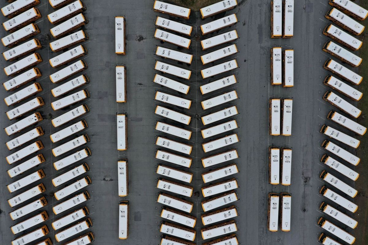 About 200 school buses are parked at the Montgomery County Schools Clarksburg Bus Depot, idled by the closing of schools across Maryland in response to the novel coronavirus outbreak March 16, 2020 in Clarksburg, Maryland. PHOTO: GETTY IMAGES/AFP