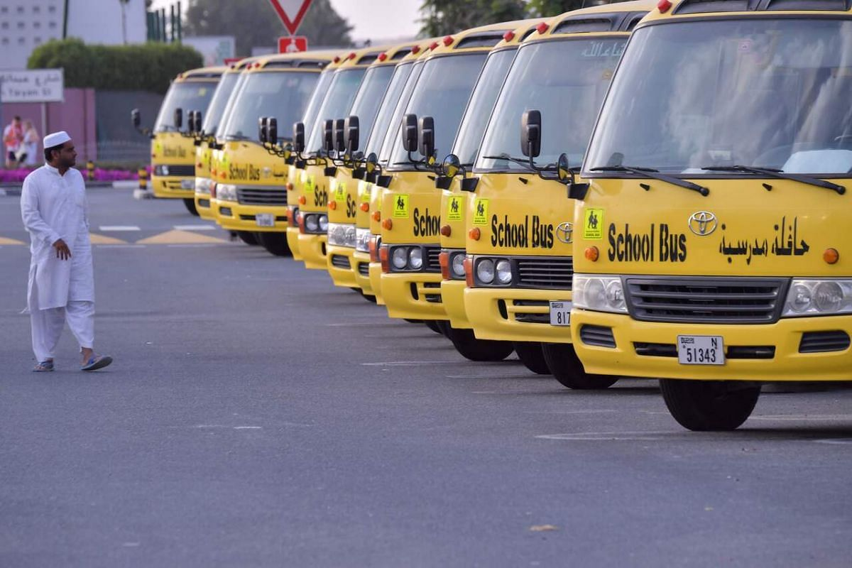 School buses parked outside a closed school in Dubai on March 15, 2020.