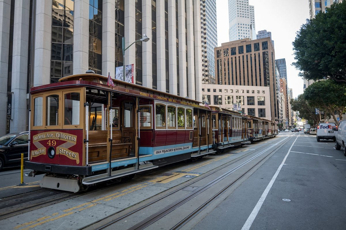 Empty cable cars stand on California Street in San Francisco, California, on March 16, 2020.