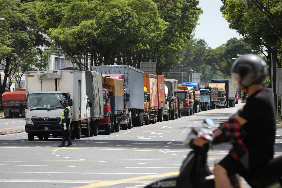 Heavy vehicles at a traffic junction near the Woodlands Checkpoint on March 17, 2020.