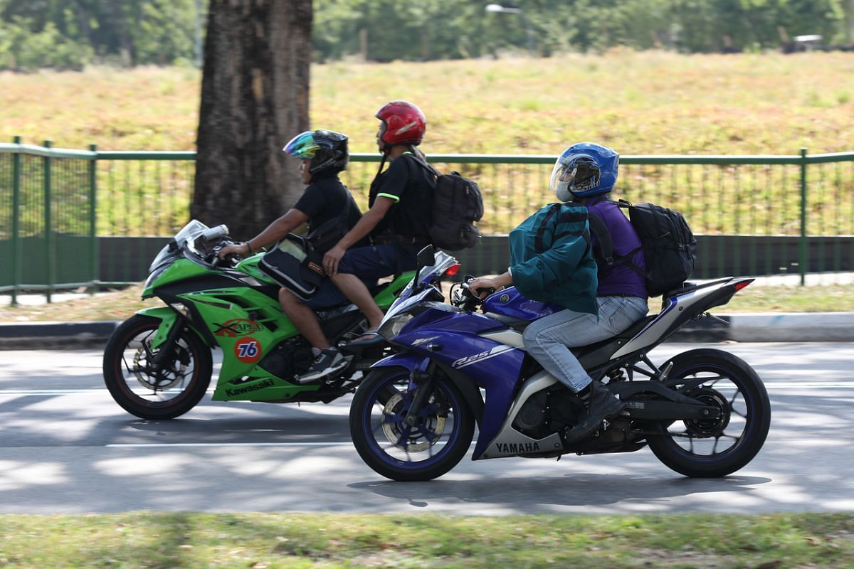Motorcyclists near Woodlands Checkpoint on March 17, 2020.