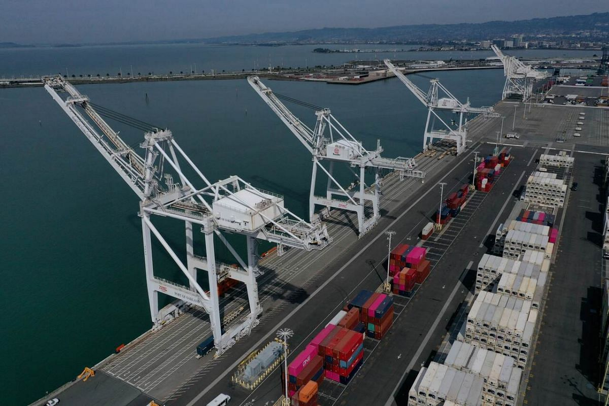 Shipping cranes sit idle at the Port of Oakland in Oakland, California, on February 28, 2020.