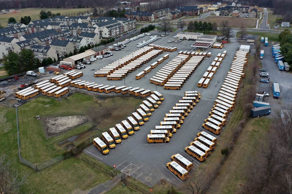 About 200 school buses are parked at the Montgomery County Schools Clarksburg Bus Depot in Clarksburg, Maryland on March 16, 2020.