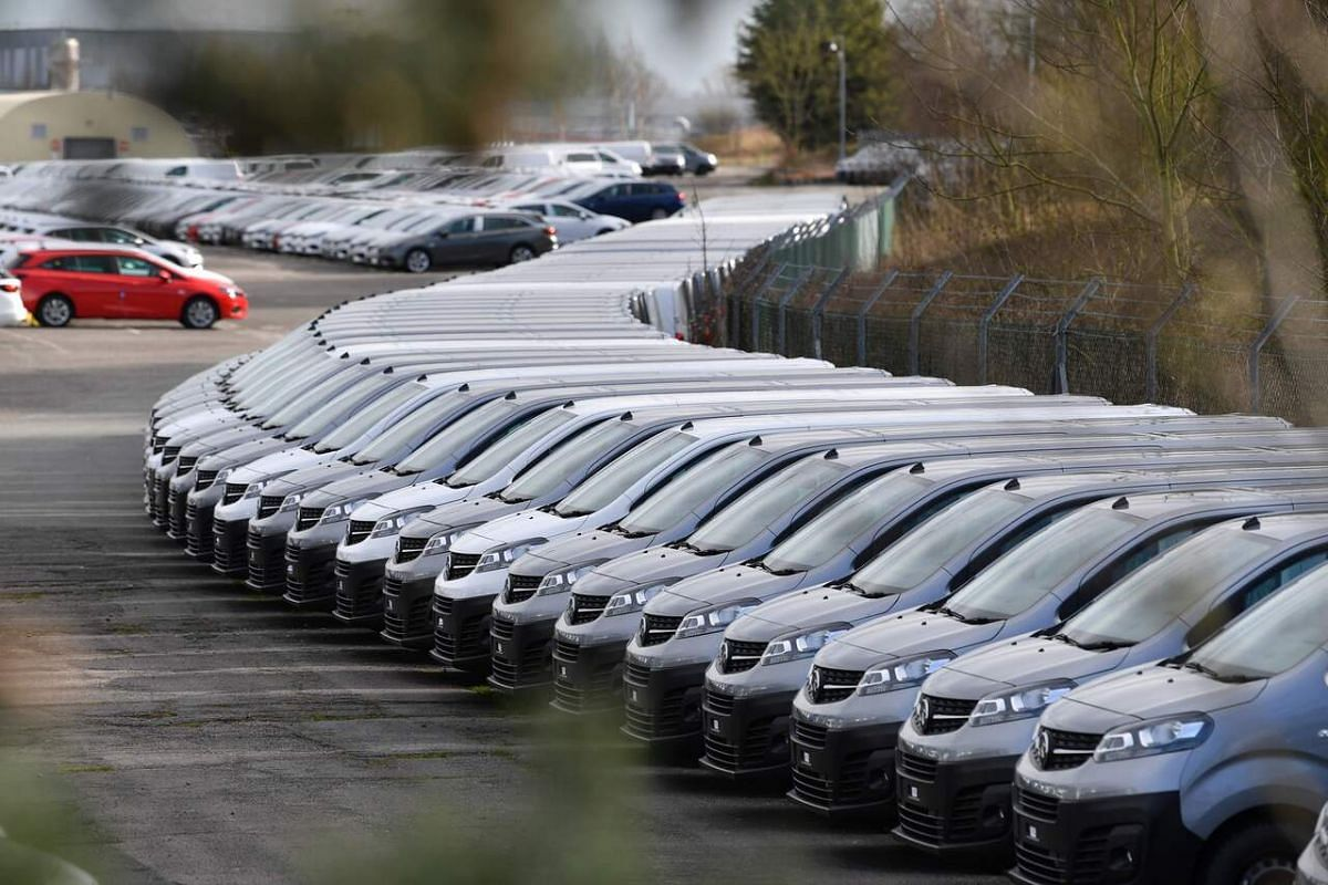 Cars parked at the Vauxhall factory in Ellesmere Port, east of Liverpool, on March 16, 2020.