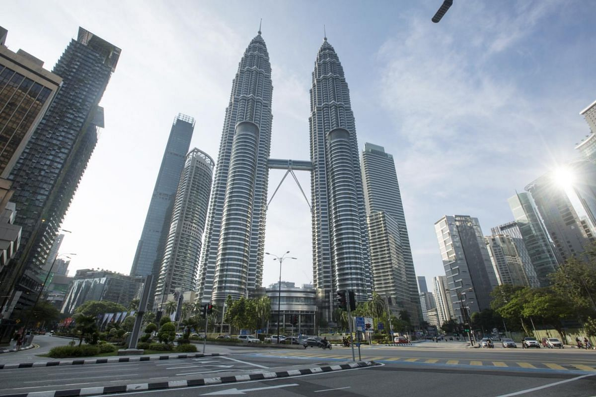 Light traffic is seen during rush hour near the Petronas Towers during a lockdown in Kuala Lumpur on March 18, 2020.