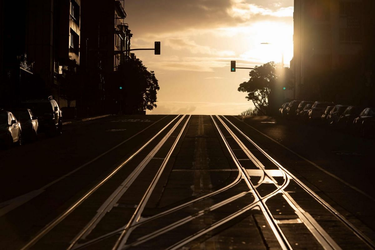 California Street, usually filled with cable cars, is seen empty in San Francisco, California on March 18, 2020.  San Francisco, along with seven other Bay Area counties, have ordered residents to shelter in place in an effort to help prevent the spr