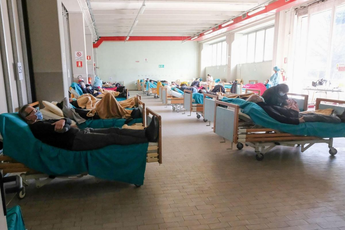 A hospital room is filled with patients at the emergency department of the Spedali Civili in Brescia, Italy, on March 16, 2020.