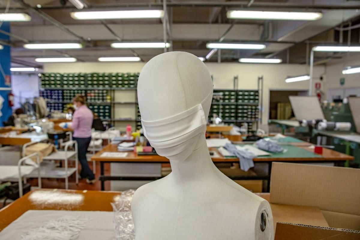 A protective face mask sits on a mannequin at the Miroglio Fashion Srl headquarters, which has switched its production line from producing female clothing and accessories to make masks, in Alba, Italy, on March 19, 2020.