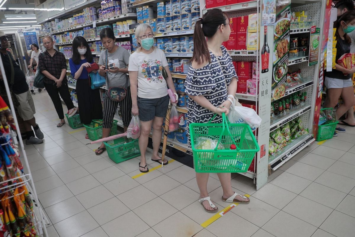 Some shoppers keeping their distance from one another at a FairPrice supermarket in Toa Payoh on March 21, 2020.