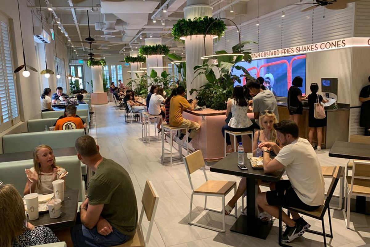 Seats and tables are set further apart at Shake Shack in Neil Road on March 21, 2020.