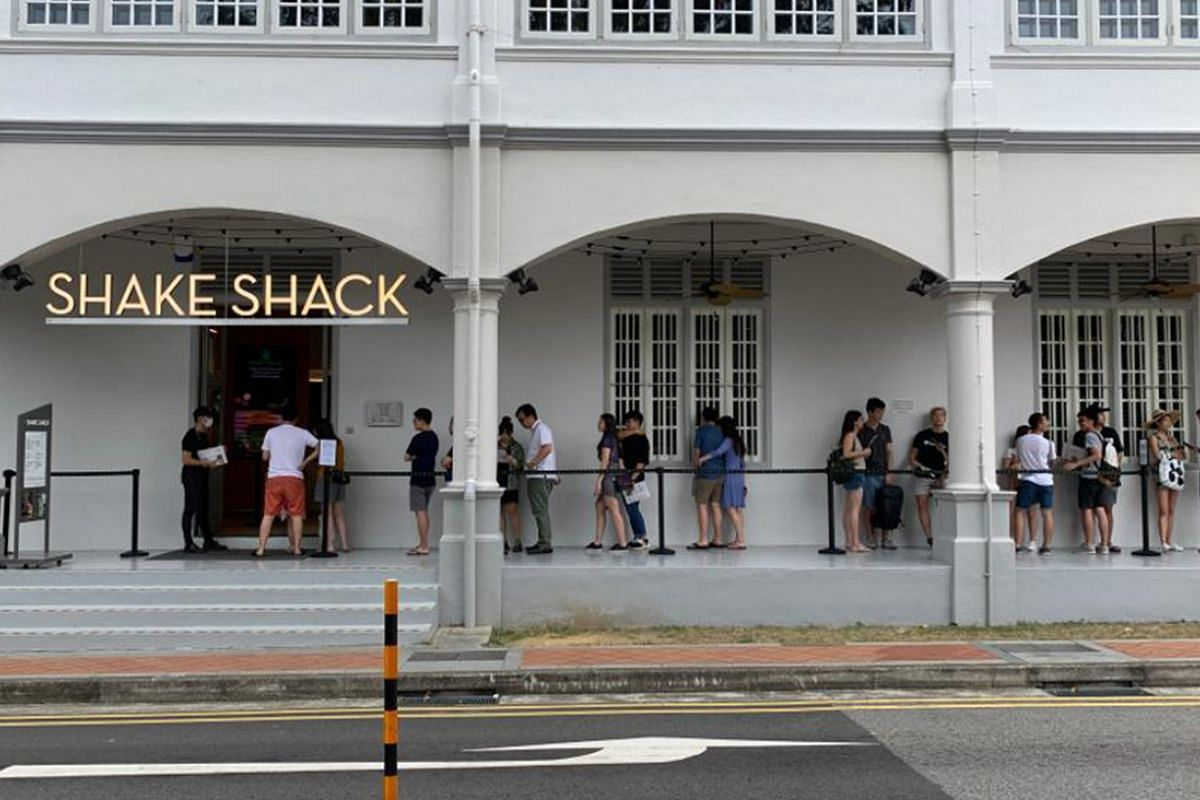 Groups of diners keeping their distance in a queue outside Shake Shack in Neil Road on March 21, 2020.