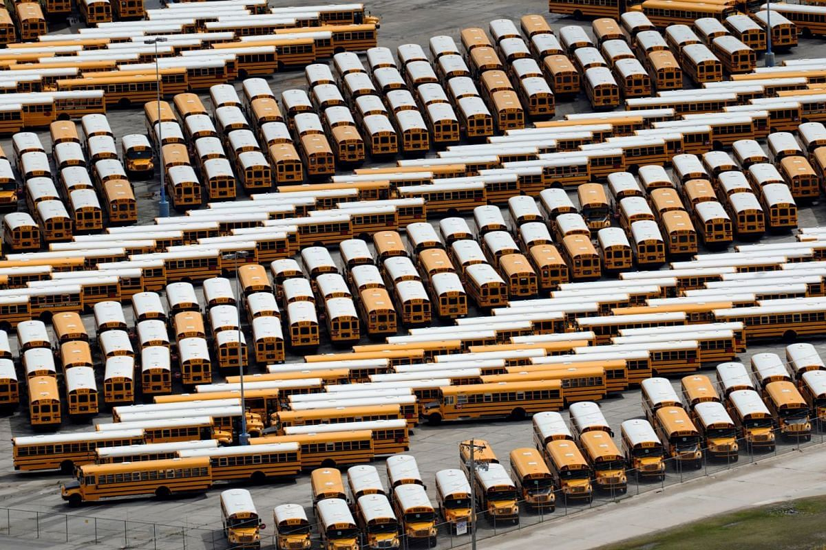 School buses wait to be shipped at the IC of Oklahoma Tulsa Bus Plant in Tulsa, Oklahoma, on March 23, 2020.