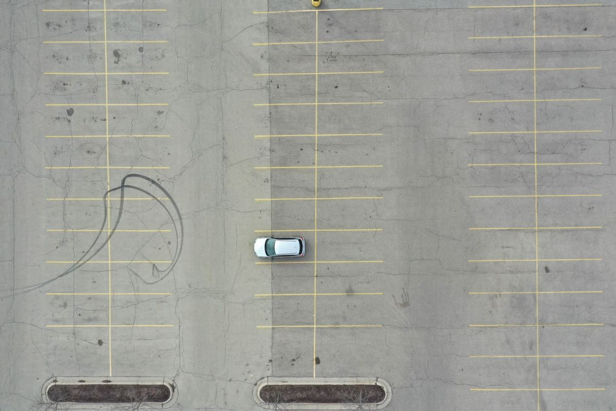 The parking lot is nearly deserted at Forest Plaza in Rockford, Illinois.